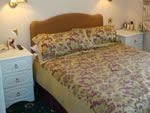 A double bedroom at Hunters Lodge Hotel